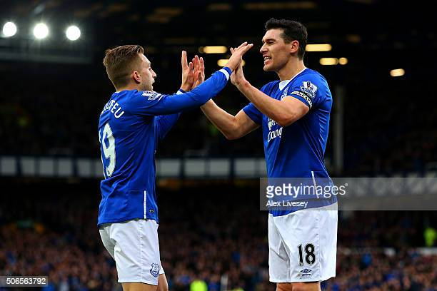 Gareth Barry of Everton celebrates with teammate Gerard Deulofeu after scoring his team's first goal during the Barclays Premier League match between...