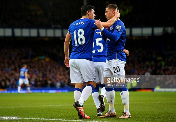 Gareth Barry of Everton celebrates with teammate Ross Barkley after scoring his team's first goal during the Barclays Premier League match between...