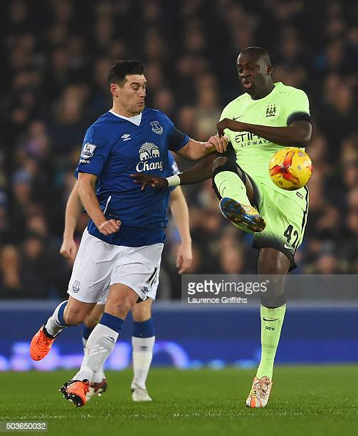 Gareth Barry of Everton challenges Yaya Toure of Manchester City during the Capital One Cup Semi Final First Leg match between Everton and Manchester...