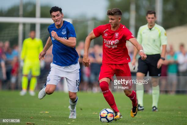 Gareth Barry of Everton FC Alexander Laukart of FC Twente during the friendly match between FC Twente and Everton FC at sportpark De Stockakker on...