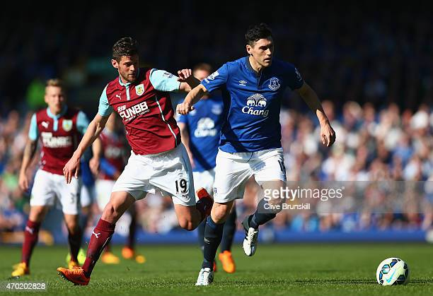 Gareth Barry of Everton holds off Lukas Jutkiewicz of Burnley during the Barclays Premier League match between Everton and Burnley at Goodison Park...