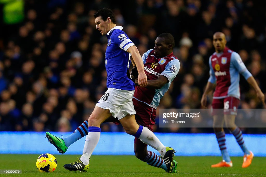 Gareth Barry (L) of Everton in action with Christian Benteke of Aston Villa during the Barclays Premier League match between Everton and Aston Villa at Goodison Park on February 1, 2014 in Liverpool, England.