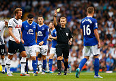 Gareth Barry of Everton is shown a yellow card by referee Mike Jones during the Barclays Premier League match between Tottenham Hotspur and Everton...