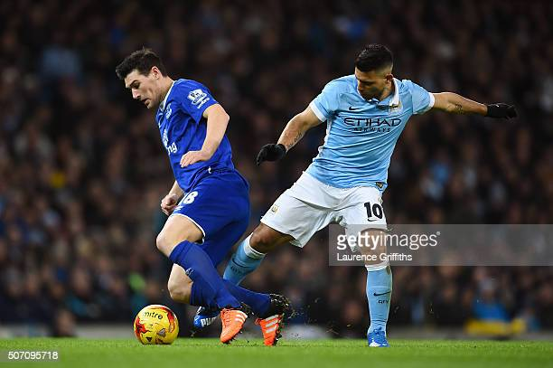 Gareth Barry of Everton is tackled by Sergio Aguero of Manchester City during the Capital One Cup Semi Final second leg match between Manchester City...