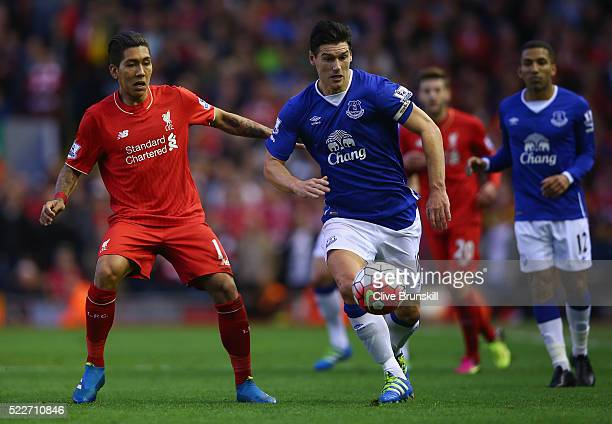 Gareth Barry of Everton moves away from Roberto Firmino of Liverpool during the Barclays Premier League match between Liverpool and Everton at...