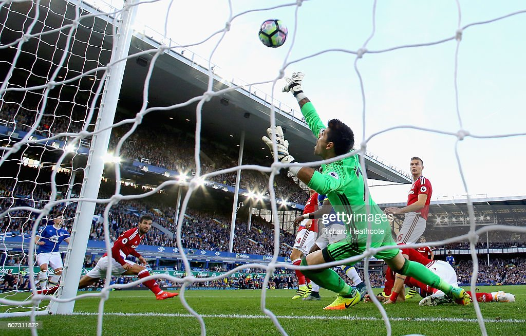 Gareth Barry of Everton (L) scores their first goal on his 600th Premier League appearance past goalkeeper Victor Valdes of Middlesbrough during the Premier League match between Everton and Middlesbrough at Goodison Park on September 17, 2016 in Liverpool, England.