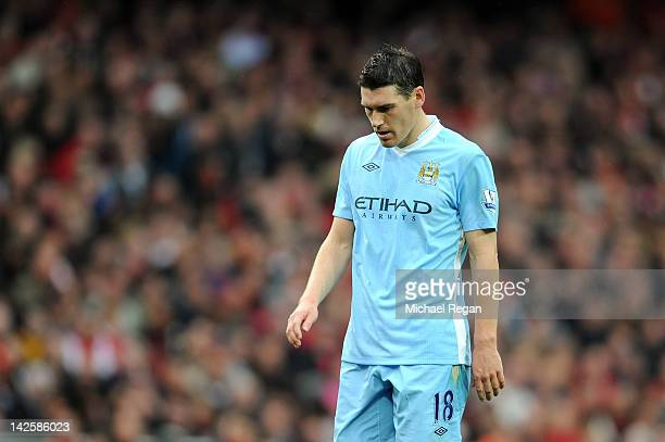 Gareth Barry of Man City looks dejected during the Barclays Premier League match between Arsenal and Manchester City at Emirates Stadium on April 8...