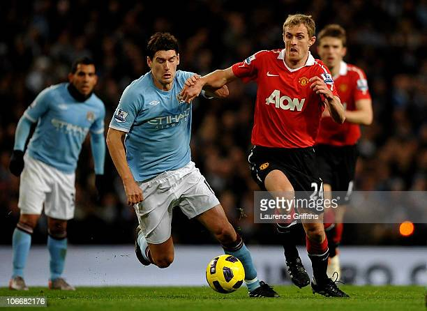 Gareth Barry of Manchester City battles for the ball with Darren Fletcher of Manchester United during the Barclays Premier League match between...