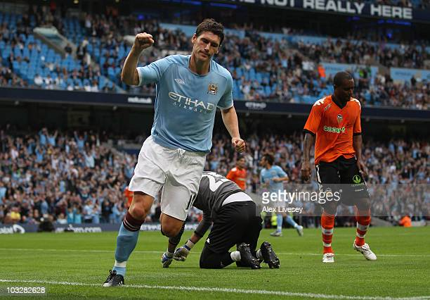 Gareth Barry of Manchester City celebrates after scoring the opening goal during the preseason friendly match between Manchester City and Valencia at...