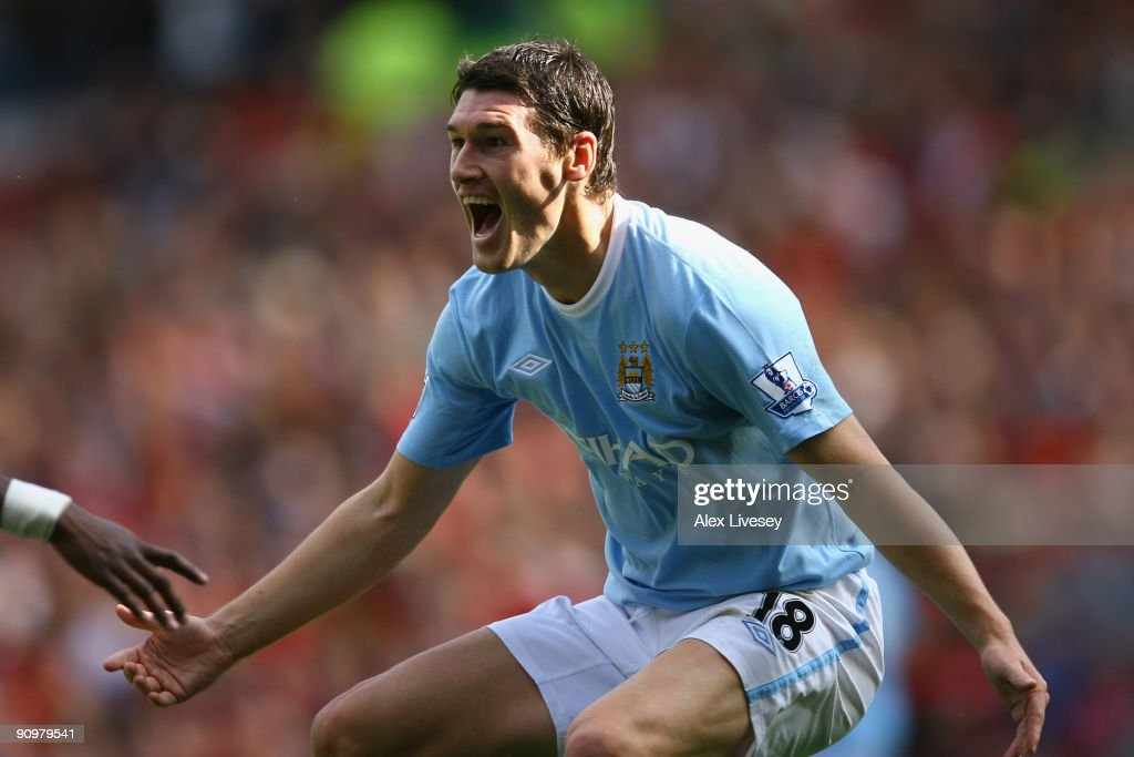 <a gi-track='captionPersonalityLinkClicked' href=/galleries/search?phrase=Gareth+Barry&family=editorial&specificpeople=209123 ng-click='$event.stopPropagation()'>Gareth Barry</a> of Manchester City celebrates scoring his team's first goal during the Barclays Premier League match between Manchester United and Manchester City at Old Trafford on September 20, 2009 in Manchester, England.