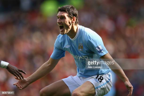 Gareth Barry of Manchester City celebrates scoring his team's first goal during the Barclays Premier League match between Manchester United and...