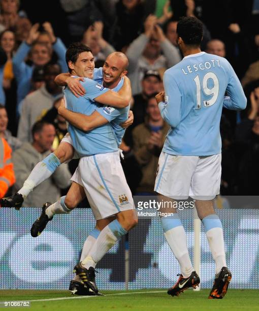 Gareth Barry of Manchester City celebrates scoring the equaliser to make it 11 with Stephen Ireland and Joleon Lescott during the Carling Cup third...
