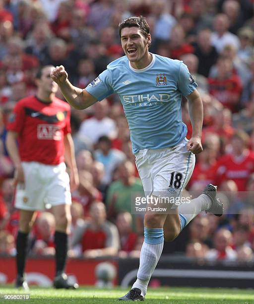 Gareth Barry of Manchester City celebrates scoring their first goal during the Barclays Premier League match between Manchester United and Manchester...