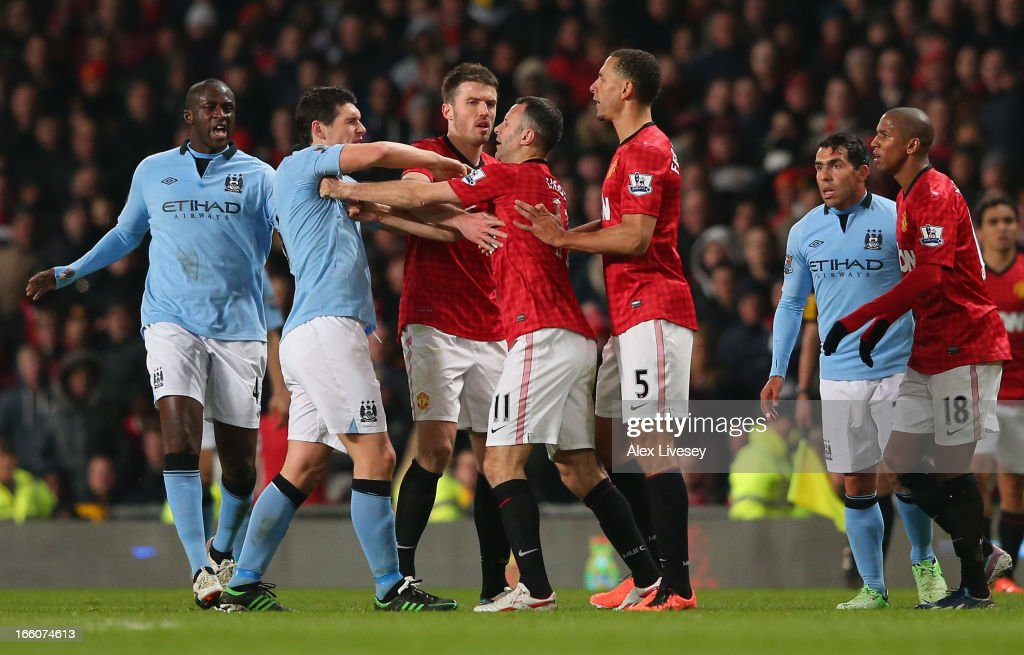 Gareth Barry of Manchester City clashes with Ryan Giggs and Rio Ferdinand of Manchester United during the Barclays Premier League match between Manchester United and Manchester City at Old Trafford on April 8, 2013 in Manchester, England.