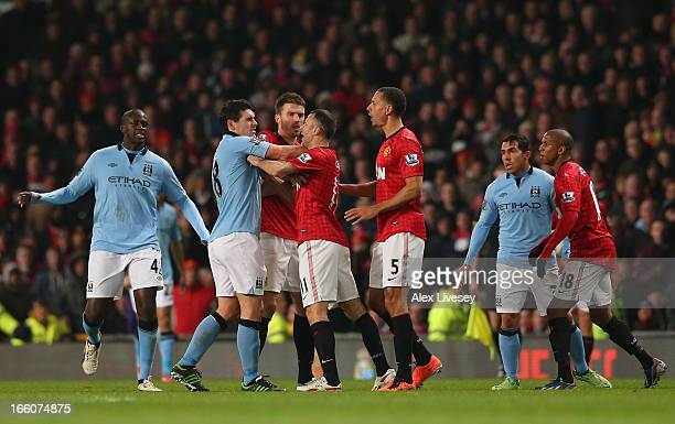Gareth Barry of Manchester City clashes with Ryan Giggs of Manchester United during the Barclays Premier League match between Manchester United and...