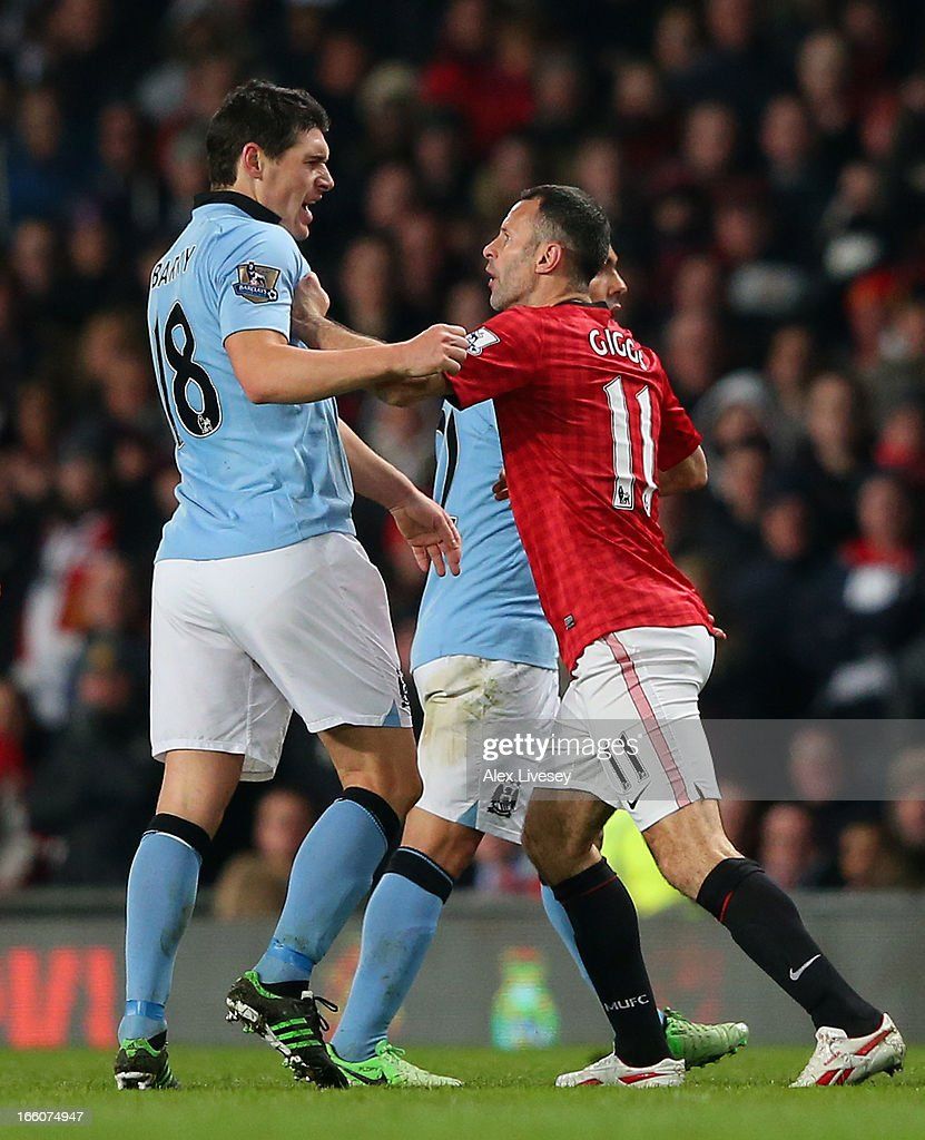 Gareth Barry of Manchester City clashes with Ryan Giggs of Manchester United during the Barclays Premier League match between Manchester United and Manchester City at Old Trafford on April 8, 2013 in Manchester, England.