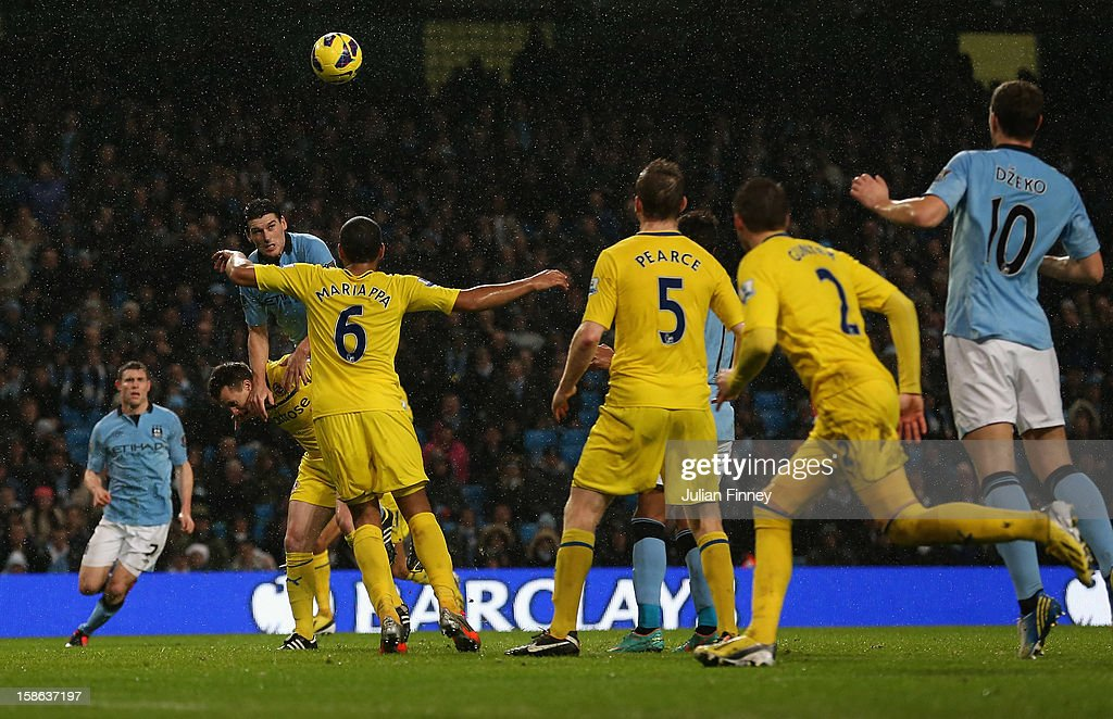 <a gi-track='captionPersonalityLinkClicked' href=/galleries/search?phrase=Gareth+Barry&family=editorial&specificpeople=209123 ng-click='$event.stopPropagation()'>Gareth Barry</a> of Manchester City climbs on <a gi-track='captionPersonalityLinkClicked' href=/galleries/search?phrase=Nicky+Shorey&family=editorial&specificpeople=786022 ng-click='$event.stopPropagation()'>Nicky Shorey</a> of Reading as he scores a header during the Barclays Premier League match between Manchester City and Reading at Etihad Stadium on December 22, 2012 in Manchester, England.