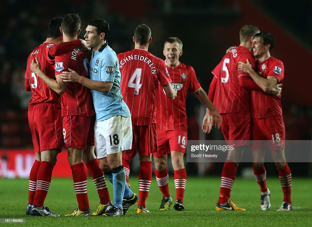 Gareth Barry of Manchester City congratulates Jay Rodriguez of Southampton as Southampton players celebrate victory at the final whistle during the Barclays Premier League match between Southampton and Manchester City at St Mary's Stadium on February 9, 2013 in Southampton, England.