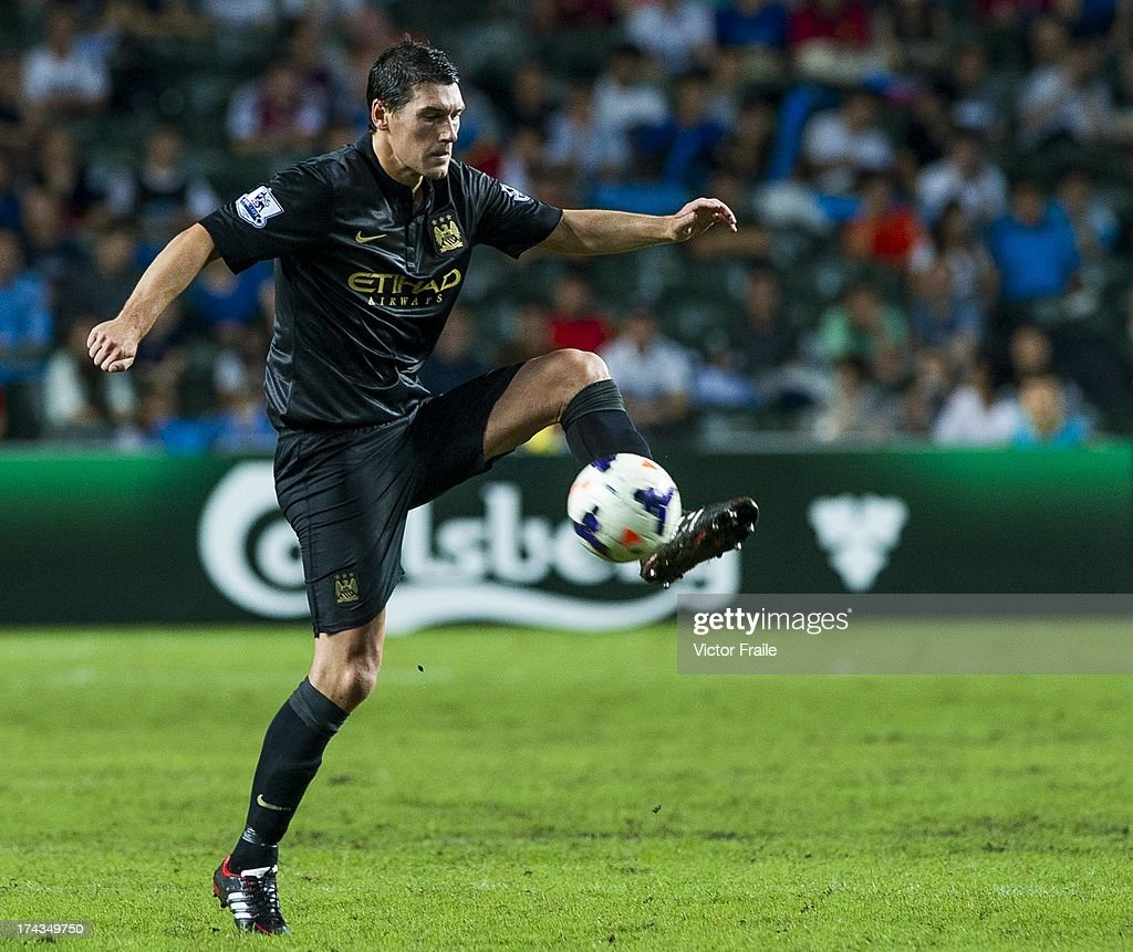<a gi-track='captionPersonalityLinkClicked' href=/galleries/search?phrase=Gareth+Barry&family=editorial&specificpeople=209123 ng-click='$event.stopPropagation()'>Gareth Barry</a> of Manchester City controls the ball during the Barclays Asia Trophy Semi Final match between Manchester City and South China at Hong Kong Stadium on July 24, 2013 in So Kon Po, Hong Kong.