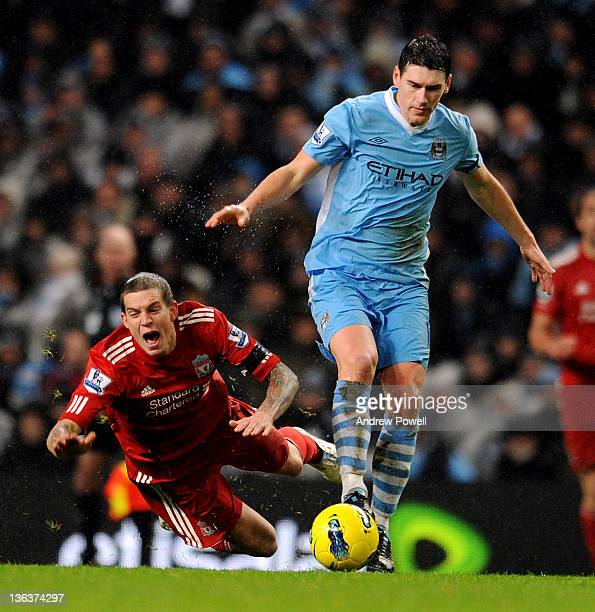 Gareth Barry of Manchester City fouls Daniel Agger of Liverpool during the Barclays Premier League match between Manchester City and Liverpool at...