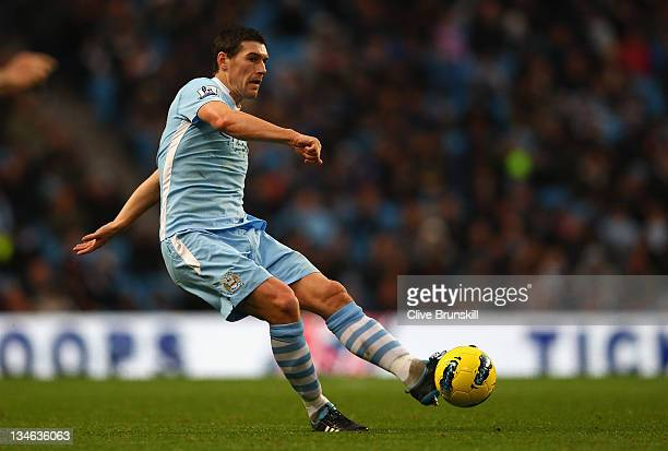 Gareth Barry of Manchester City in action during the Barclays Premier League match between Manchester City and Norwich City at Etihad Stadium on...