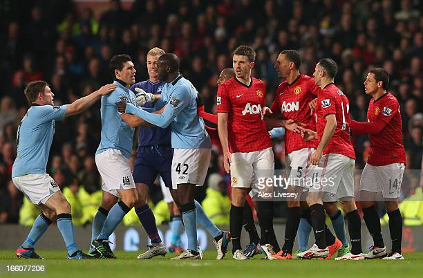 Gareth Barry of Manchester City is restrained as he clashes with Rio Ferdinand of Manchester United during the Barclays Premier League match between...