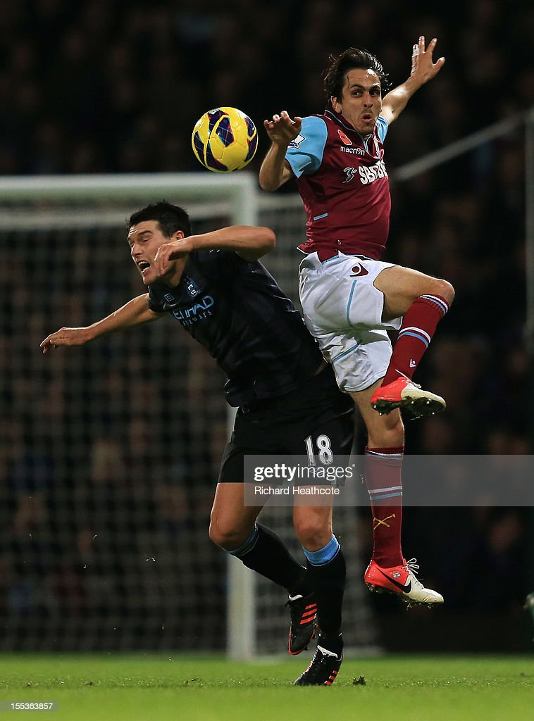 <a gi-track='captionPersonalityLinkClicked' href=/galleries/search?phrase=Gareth+Barry&family=editorial&specificpeople=209123 ng-click='$event.stopPropagation()'>Gareth Barry</a> of Manchester City jumps for a header with <a gi-track='captionPersonalityLinkClicked' href=/galleries/search?phrase=Yossi+Benayoun&family=editorial&specificpeople=635033 ng-click='$event.stopPropagation()'>Yossi Benayoun</a> of West Ham United during the Barclays Premier League match between West Ham United and Manchester City at the Boleyn Ground on November 3, 2012 in London, England.