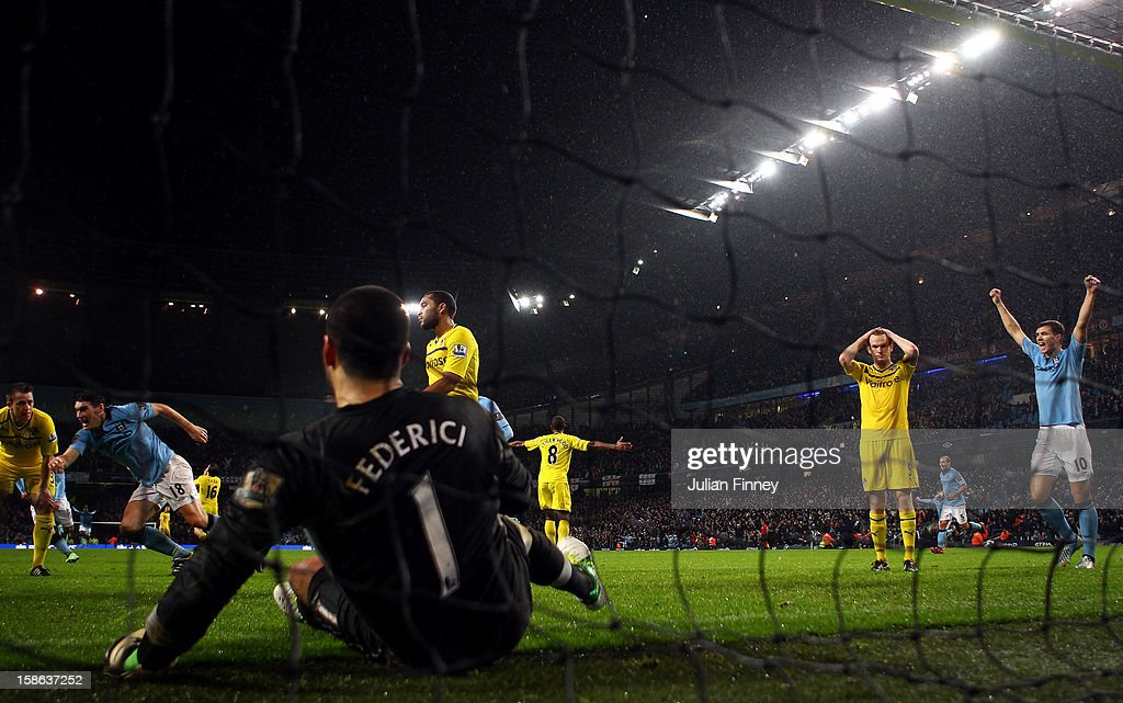 Gareth Barry of Manchester City runs to celebrate after scoring a header past Adam Federici of Reading during the Barclays Premier League match between Manchester City and Reading at Etihad Stadium on December 22, 2012 in Manchester, England.