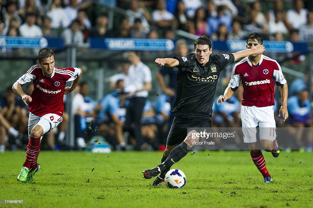 <a gi-track='captionPersonalityLinkClicked' href=/galleries/search?phrase=Gareth+Barry&family=editorial&specificpeople=209123 ng-click='$event.stopPropagation()'>Gareth Barry</a> (C) of Manchester City runs with the ball during the Barclays Asia Trophy Semi Final match between Manchester City and South China at Hong Kong Stadium on July 24, 2013 in So Kon Po, Hong Kong.