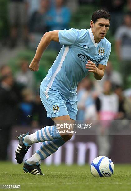Gareth Barry of Manchester City runs with the ball during the Dublin Super Cup match between Inter Milan and Manchester City at the Aviva Stadium on...