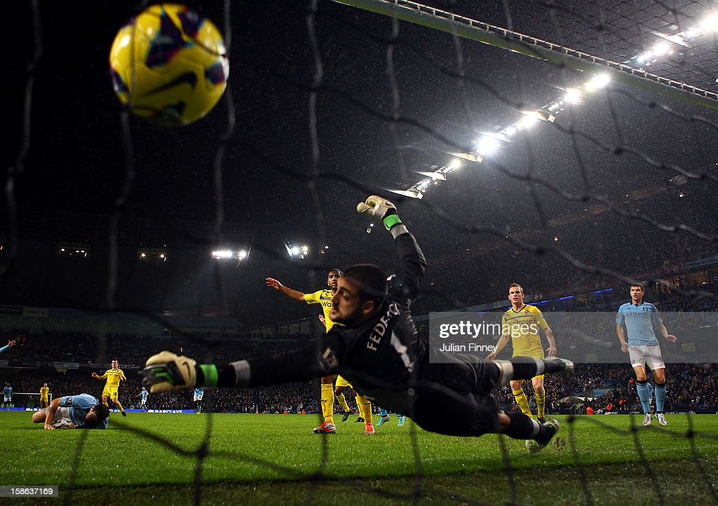 Gareth Barry of Manchester City scores a header past Adam Federici of Reading during the Barclays Premier League match between Manchester City and Reading at Etihad Stadium on December 22, 2012 in Manchester, England.