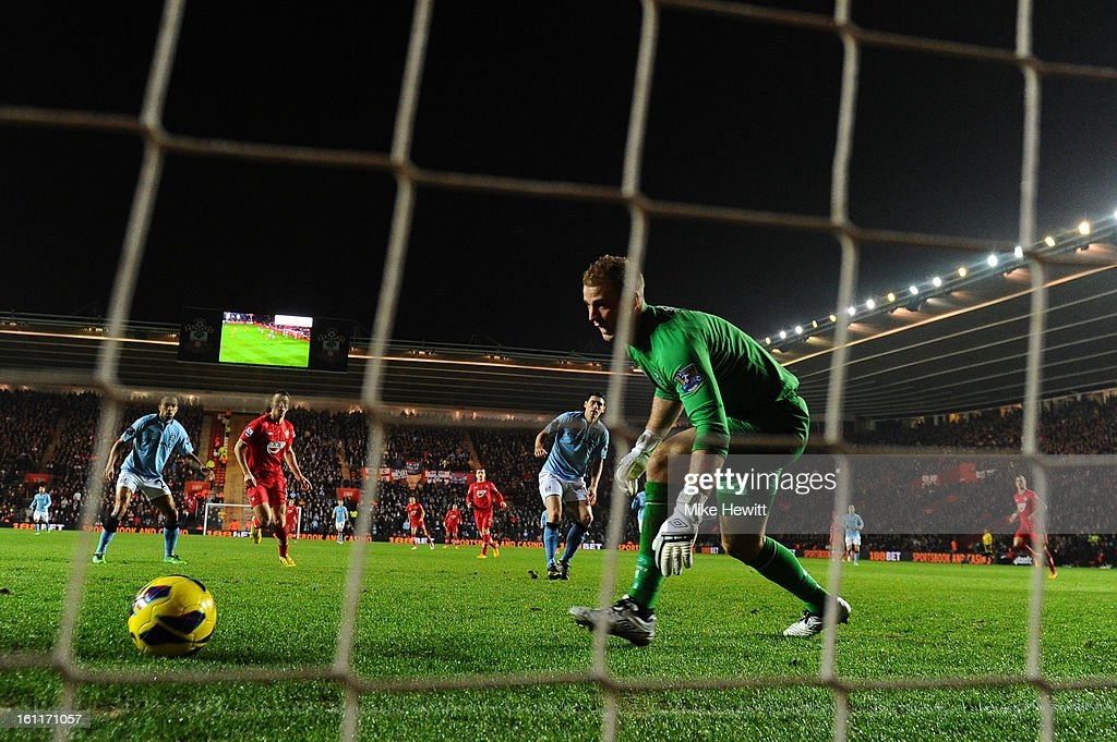 <a gi-track='captionPersonalityLinkClicked' href=/galleries/search?phrase=Gareth+Barry&family=editorial&specificpeople=209123 ng-click='$event.stopPropagation()'>Gareth Barry</a> of Manchester City scores an own goal during the Barclays Premier League match between Southampton and Manchester City at St Mary's Stadium on February 9, 2013 in Southampton, England.