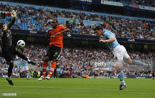 Gareth Barry of Manchester City scores the opening goal during the preseason friendly match between Manchester City and Valencia at the City of...