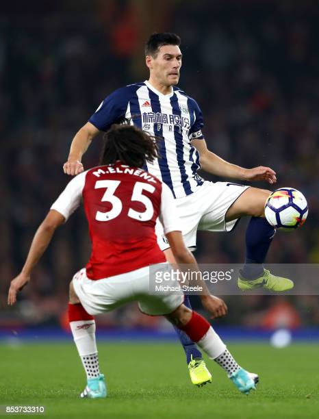 Gareth Barry of West Bromwich Albion is faced by Mohamed Elneny of Arsenal during the Premier League match between Arsenal and West Bromwich Albion...
