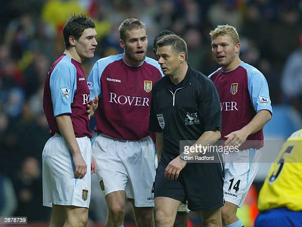 Gareth Barry Olof Mellberg and Marcus Allback of Aston Villa surround referee Mr M Halsey to complain about the penalty Arsenal were awarded during...