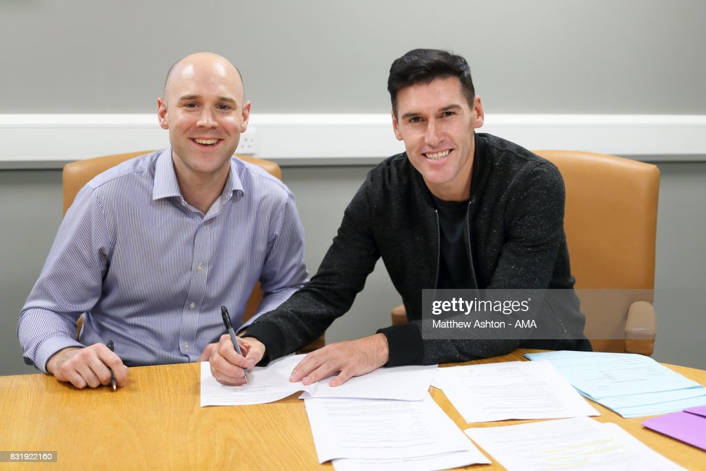 Gareth Barry signs for West Bromwich Albion with Gareth Barry with Simon Carrington General Counsel / Club Secretary on August 15, 2017 in West Bromwich, England.
