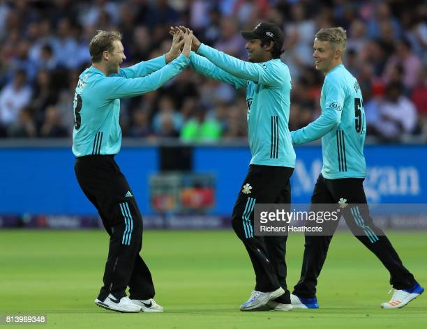 Gareth Batty and Kumar Sangakkara of Surrey celebrate taking the wicket of Brendon McCullum of Middlesex during the NatWest T20 Blast match between...