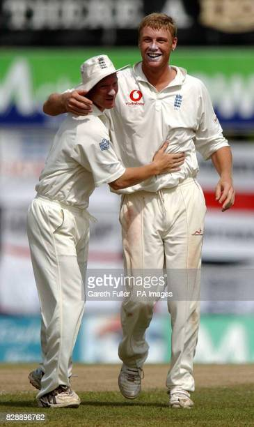 Gareth Batty congratulates Andrew Flintoff after he took the wicket of Hashan Tillakaratne to bring the only success of the morning session as...