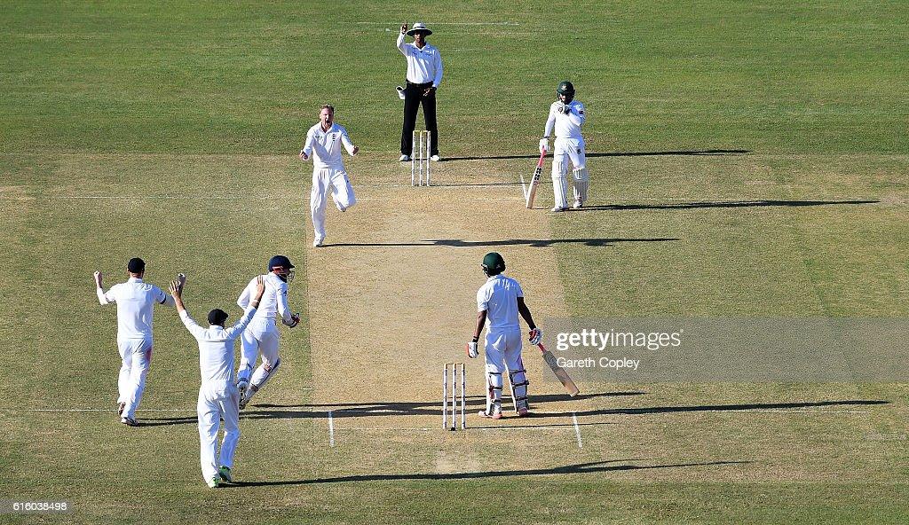 Gareth Batty of England celebrates dismissing Tamin Iqbal of Bangladesh during day two of the first Test between Bangladesh and England at Zohur Ahmed Chowdhury Stadium on October 21, 2016 in Chittagong, Bangladesh.