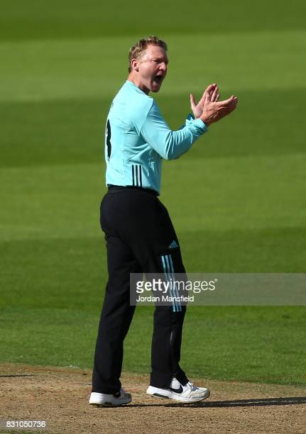 Gareth Batty of Surrey celebrates dismissing Chris Nash of Sussex during the NatWest T20 Blast match between Surrey and Sussex Shark at The Kia Oval...