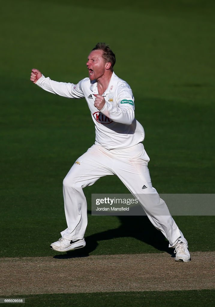 Gareth Batty of Surrey celebrates getting the wicket of Keith Barker of Warwickshire during day three of the Specsavers County Championship Division One match between Surrey and Warwickshire at The Kia Oval on April 9, 2017 in London, England.