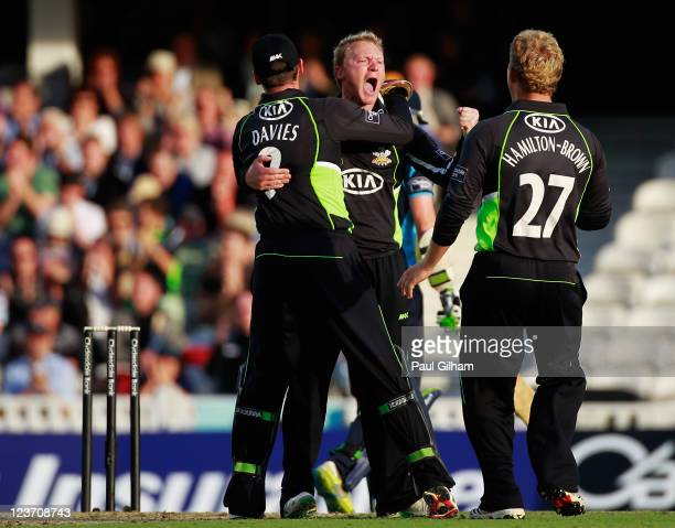 Gareth Batty of Surrey celebrates with Rory HamiltonBrown and Steve Davies after taking the wicket of Ed Joyce of Sussex for for Lbw and 47 runs...