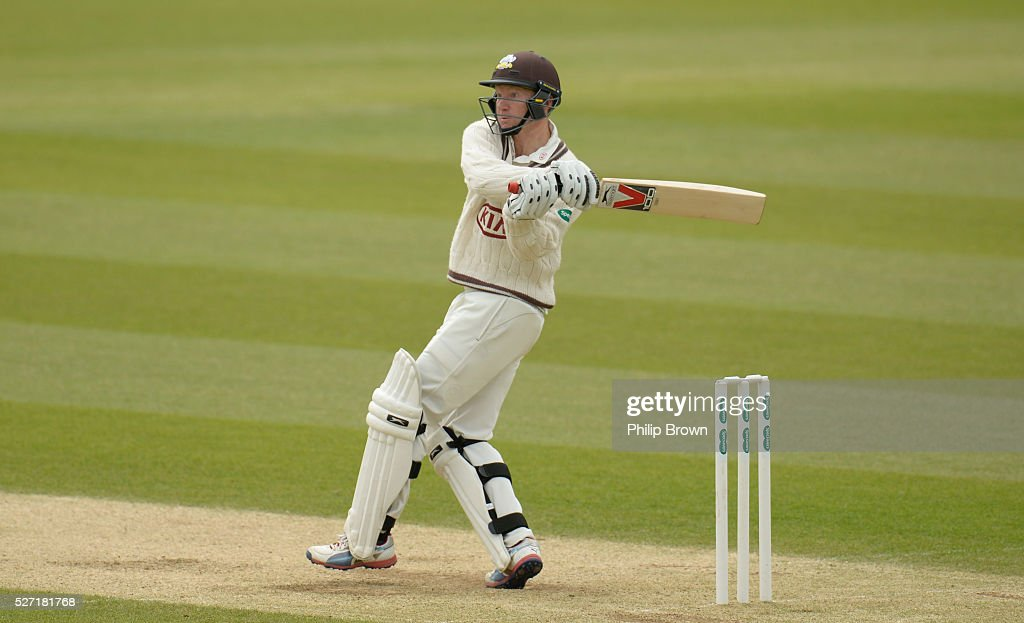 Gareth Batty of Surrey hits a six off Ben Stokes of Durham during day two of the Specsavers County Championship Division One match between Surrey and Durham at the Kia Oval on May 2, 2016 in London, England.