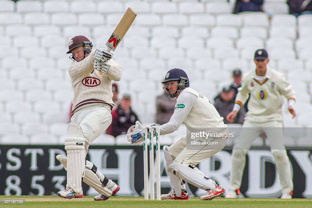 <a gi-track='captionPersonalityLinkClicked' href=/galleries/search?phrase=Gareth+Batty&family=editorial&specificpeople=215258 ng-click='$event.stopPropagation()'>Gareth Batty</a> of Surrey hits out as wicketkeeper Michael Richardson of Durham looks on during the Specsavers County Championship Division One match between Surrey and Durham at the Kia Oval Cricket Ground, on May 02, 2016 in London, England.