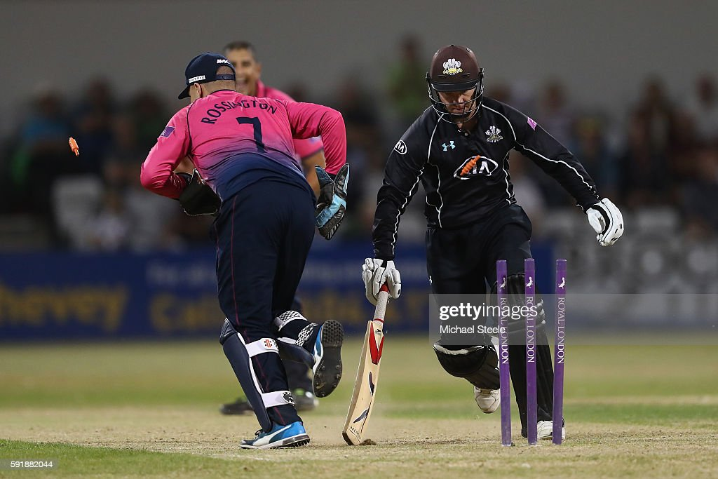 Gareth Batty of Surrey is run out by Northants wicketkeeper Adam Rossington during the Royal London One-Day Cup Quarter Final match between Northamptonshire and Surrey at The County Ground on August 18, 2016 in Northampton, England.