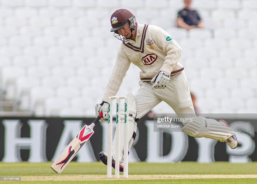 <a gi-track='captionPersonalityLinkClicked' href=/galleries/search?phrase=Gareth+Batty&family=editorial&specificpeople=215258 ng-click='$event.stopPropagation()'>Gareth Batty</a> of Surrey runs a single during the Specsavers County Championship Division One match between Surrey and Durham at the Kia Oval Cricket Ground, on May 02, 2016 in London, England.