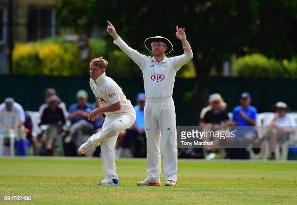 Gareth Batty of Surrey sets his fielders as Sam Curran of Surrey prepares to bowl during the Specsavers County Championship Division One match...