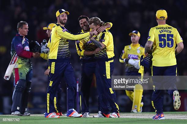 Gareth Berg of Hampshire celebrates with James Vince and Shahid Afridi after taking the last wicket of David Griffiths of Kent during the NatWest T20...