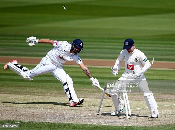 Gareth Berg of Hampshire runs himself out on 99 runs by Matt Hobden of Sussex while wicket keeper Ben Brown celebrates during day two of the LV...
