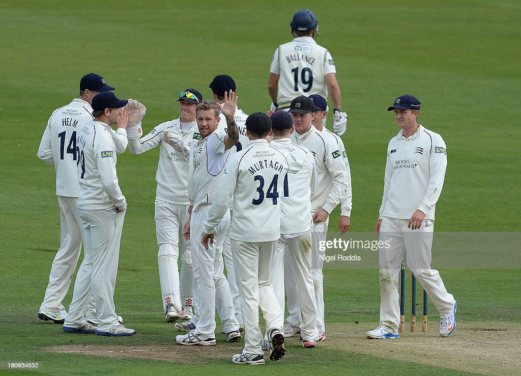 Gareth Berg (C) of Middlesex celebrates taking the wicket of <a gi-track='captionPersonalityLinkClicked' href=/galleries/search?phrase=Gary+Ballance&family=editorial&specificpeople=7811120 ng-click='$event.stopPropagation()'>Gary Ballance</a> (2ndR) of Yorkshire during day two of the LV County Championship Division One match between Yorkshire and Middlesex at Headingley Stadium on September 18, 2013 in Leeds, England.